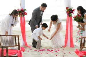 Ring Bearer drops ring in the sand