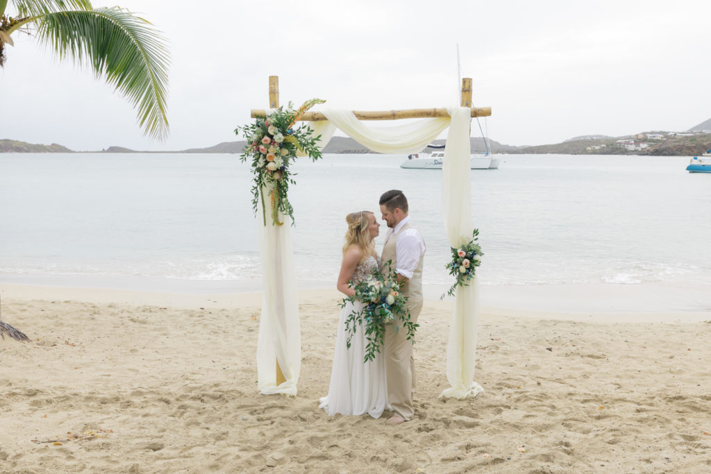 Secret Harbour Beach Wedding under the arch couple